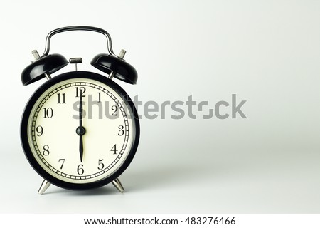Alarm Clock isolated on white, showing six o'clock.