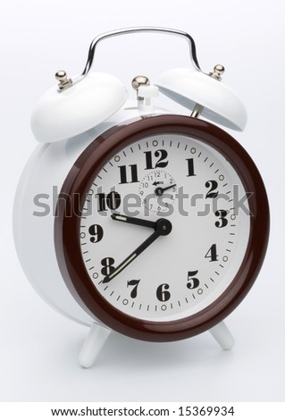 Alarm clock on a white background - stock photo