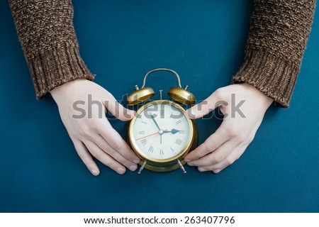 Alarm clock on businessman's hand, Time over concept - stock photo