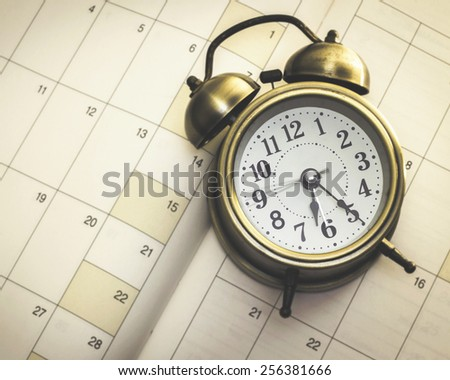 alarm clock on diary book - stock photo
