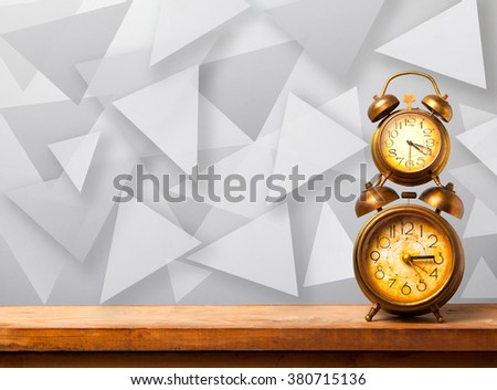 alarm clock on the abstract background - stock photo
