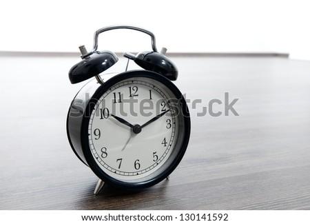Alarm clock on the floor - stock photo