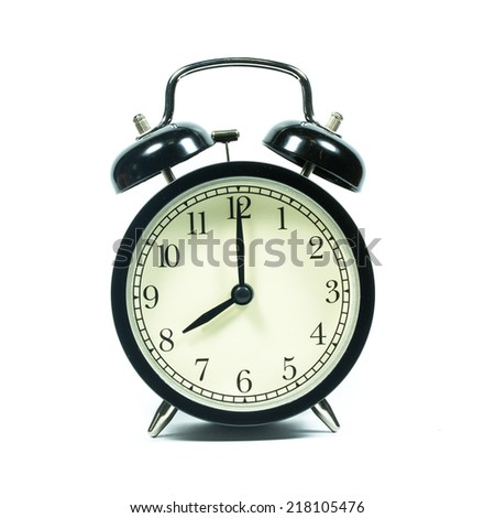 Alarm clock on white background. At 8 .