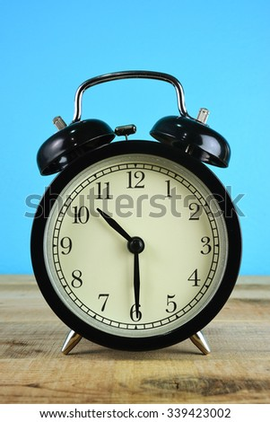 Alarm clock on wooden.