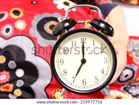 Alarm clock showing seven o'clock in the morning