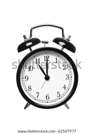 Alarm clock shows eleven o`clock isolated on white background