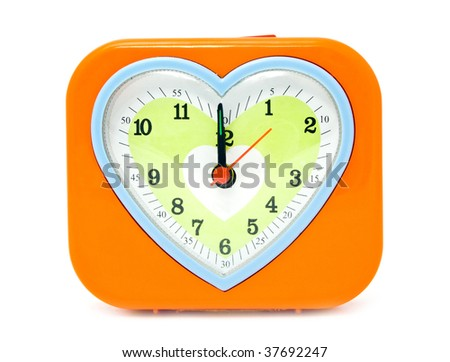 alarm clock with a heart on a white background