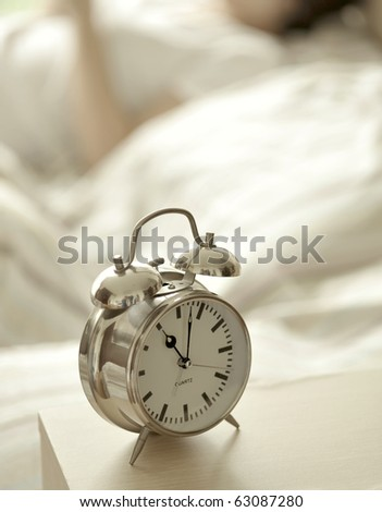alarm clock with bed - stock photo