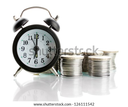 Alarm clock with coins isolated on white - stock photo