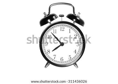 Alarm clock with 7 min before 8 o`clock on white background