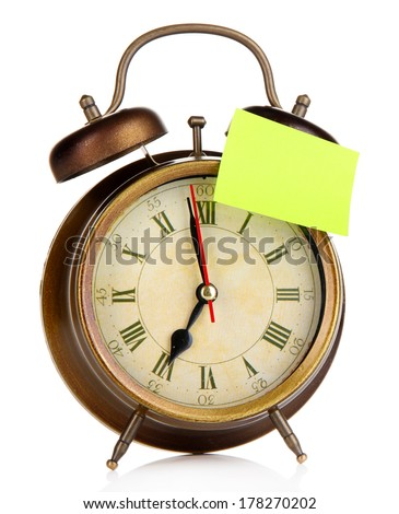 Alarm clock with sticker isolated on white - stock photo
