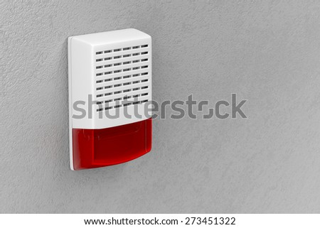 Alarm siren with flash light attached on wall - stock photo