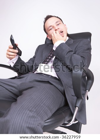 alarmed businessman sitting on chair