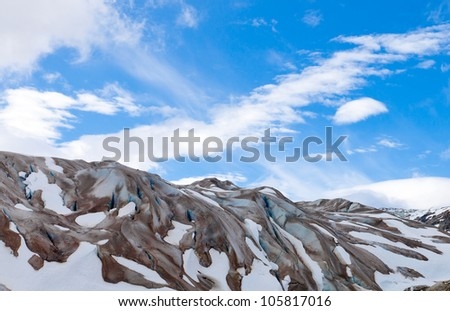 Alaska glacier with brilliant blue sky and clouds at Glacier Bay National Park - stock photo