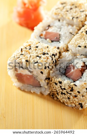 Alaska Maki Sushi - Roll with Smoked Salmon, Cream Cheese and Salmon Roe inside. Sesame outside - stock photo