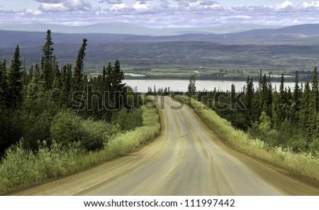 Alaska, raw gravel road north from Fairbanks - stock photo