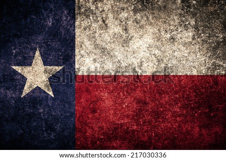 Alaska state flag on the grunge concrete wall - stock photo