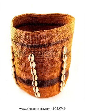 Alaskan basket decorated with cowrie shells - stock photo