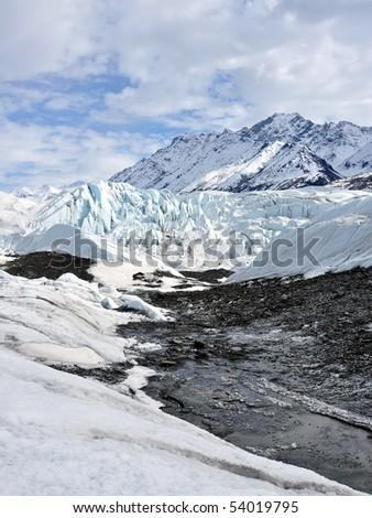 Alaskan glacier with rubble from moraine - stock photo