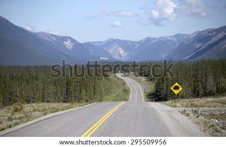 Alaskan Highway going over Canadian Rockies, Yukon, Canada - stock photo