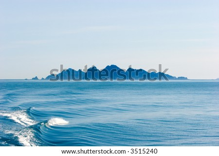 Alaskan landscape ocean and mountains - stock photo