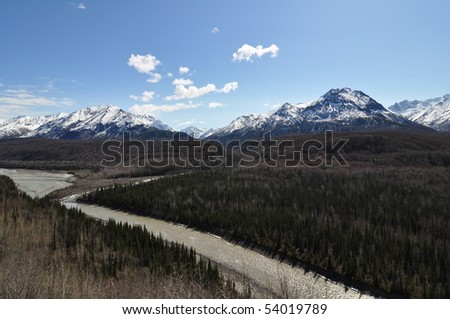 Alaskan landscape with mountains and forest - stock photo