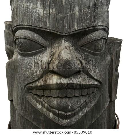 Alaskan wooden tribal totem isolated on white - stock photo