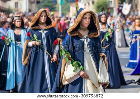 ALBA, ITALY - OCTOBER 05, 2014: Participants in historic noble dresses on Medieval Parade - part of annual White Truffle festival and celebrations taking place each year on October in Alba, Italy. - stock photo