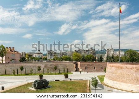 ALBA IULIA, ROMANIA - AUGUST 20, 2014: The Fortification Walls Of Carolina White Fortress Built In 1739 are 12 Kilometers Long And Were Built By Over 20 Thousand Peasants.