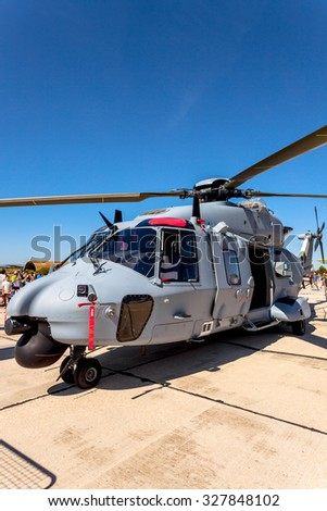 ALBACETE, SPAIN-JUN 23:  Helicopter Eurocopter NH90 taking part in a static exhibition on the open day of the airbase of Los Llanos on Jun 23, 2013, in Albacete, Spain - stock photo