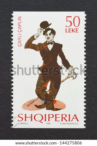ALBANIA - CIRCA 1999 a postage stamp printed in Albania showing an image of Charles Chaplin, circa 1999. - stock photo