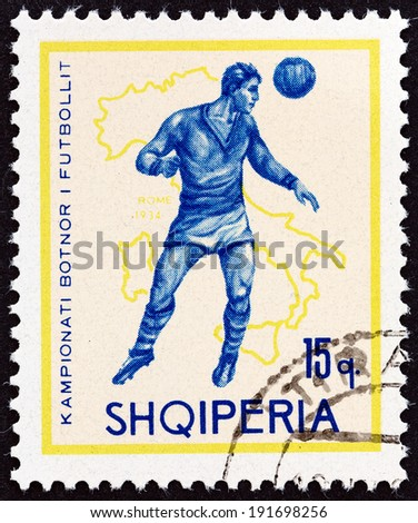 "ALBANIA - CIRCA 1966: A stamp printed in Albania from the ""Football World Cup - England "" issue shows soccer player and map of Italy (1934), circa 1966.  - stock photo"