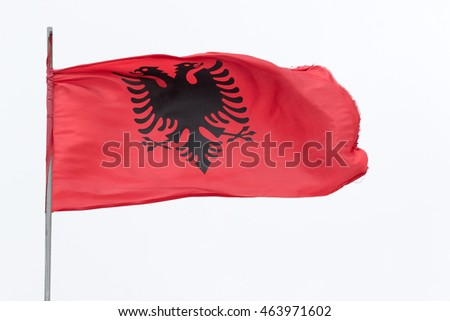 Albania flag against cloudy sky