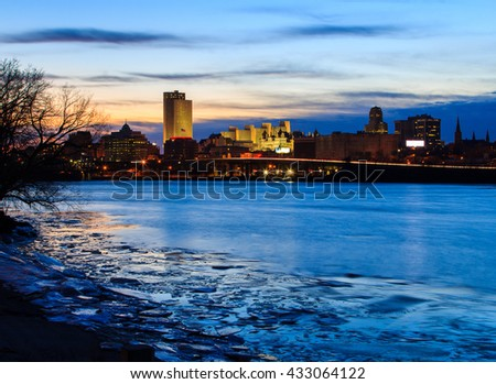 Albany NY skyline wintertime, from Rennsaeler NY, looking across. Reflections on the Hudson River include some ice. Capital city of NY. - stock photo