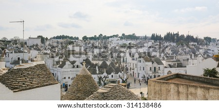 ALBEROBELLO, ITALY - MARCH 15, 2015: Trulli of Alberobello, small town of the Metropolitan City of Bari, Puglia, Southern Italy.