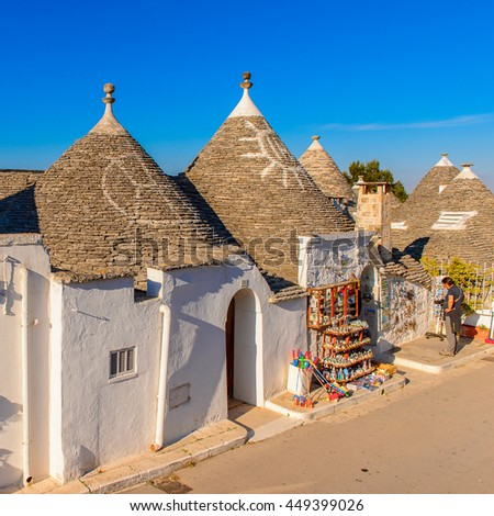 ALBEROBELLO, ITALY - MAY 9, 2016: Houses of Alberobello, a small town in Apulia, Italy. Famous for its trulli buildings. The Trulli of Alberobello have are a UNESCO World Heritage site since 1996