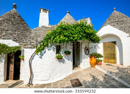 Alberobello, Italy, Puglia. Unique Trulli houses with conical roofs. Trullo, trulli, a traditional Apulian dry stone hut with a conical roof. - stock photo