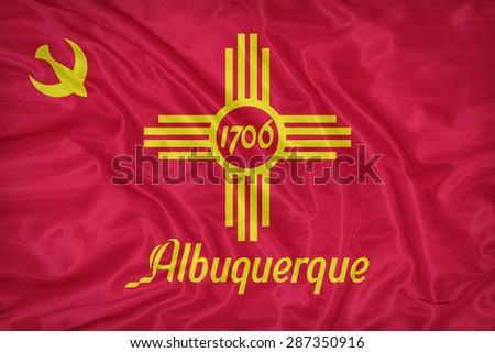 Albuquerque ,New Mexico flag on fabric texture,retro vintage style - stock photo