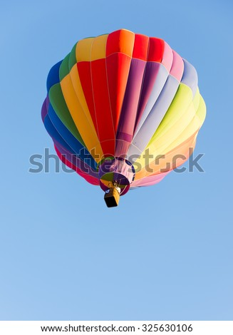 ALBUQUERQUE, NEW MEXICO - OCTOBER 6, 2015: Balloon flies over Albuquerque, New Mexico. International balloon fiesta is the biggest hot air balloon event in the world. - stock photo