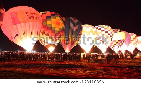 ALBUQUERQUE, NEW MEXICO - OCTOBER 9: Balloons glow during the morning glow event on October 9, 2010 in Albuquerque,New Mexico.Albuquerque balloon fiesta is the biggest balloon event in the the world. - stock photo