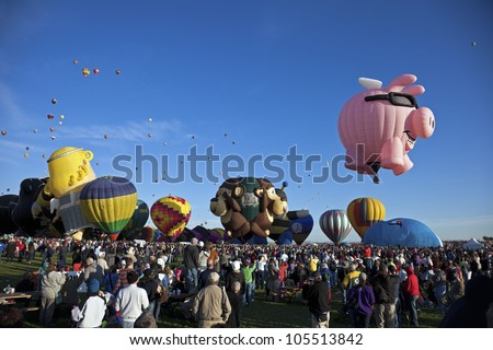 ALBUQUERQUE, NM - OCTOBER 02: Hot Air Baloon Fiesta in Albuquerque, New Mexico. Crowd of the visitors observing the ascending balloons on October 2, 2011. - stock photo