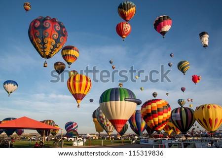 ALBUQUERQUE - OCTOBER 8: Ascension of balloons at the 2012 Albuquerque International Balloon Fiesta the morning of October 8, 2012 in Albuquerque, NM - stock photo