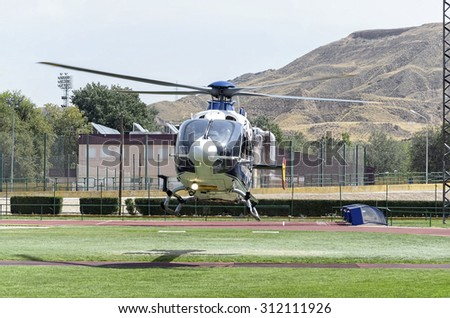 ALCALA DE HENARES, SPAIN - AUGUST 29th 2015: Helicopter is taking off, after exhibition of spanish police, in Alcala de Henares, on August 29th 2015. - stock photo