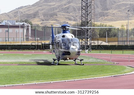 ALCALA DE HENARES, SPAIN - AUGUST 29th 2015: Unidentified spanish policemen are ready to take off on their helicopter, after a show of spanish armed forces, in Alcala de Henares, on August 29th 2015. - stock photo