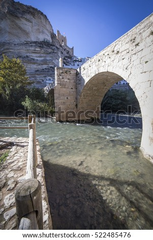 Alcala del Jucar, Spain - October 29, 2016: Roman bridge, located in the central part of the town, to its passage by the river Jucar, take in Alcala del Jucar, Albacete province, Spain