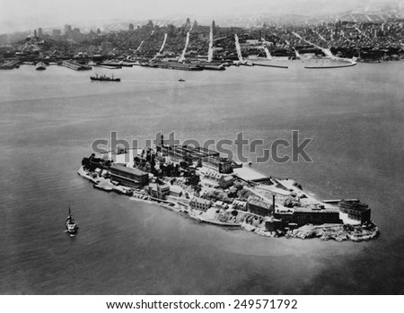 Alcatraz Federal Prison in San Francisco Bay, California, 1938. In the distance is the city of San Francisco. - stock photo