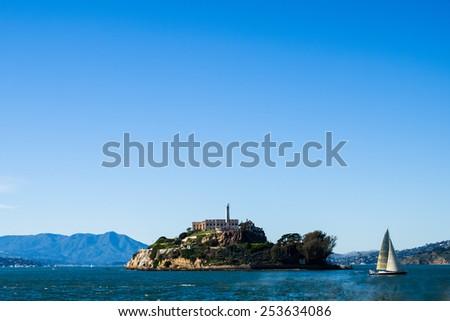 Alcatraz Island and Sail Boat - stock photo