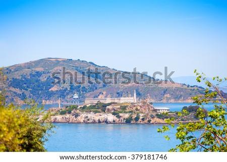 Alcatraz island though foliage in San Francisco - stock photo