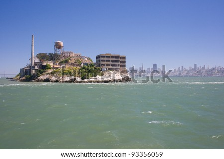 Alcatraz island with central San Francisco on background - stock photo