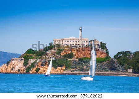 Alcatraz prison and yachts in San Francisco bay - stock photo